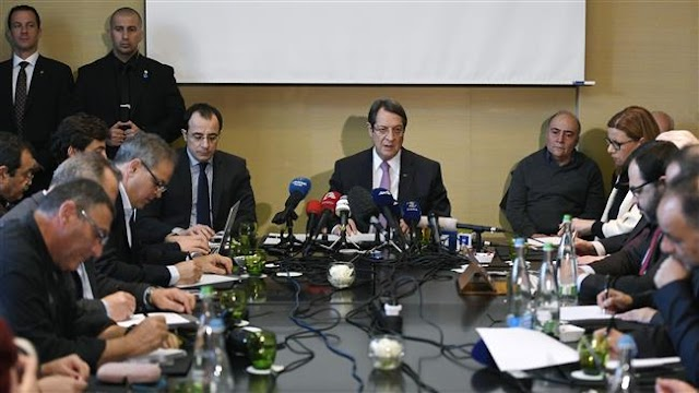 Ethnically-split Cyprus rival leaders ask UN to hold peace summit next month