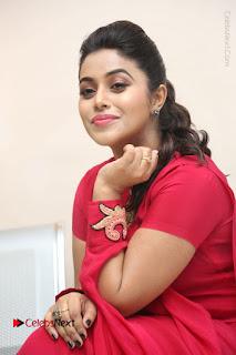 Actress Poorna Latest Stills in Red Dress at Rakshasi First Look Launch  0262.JPG