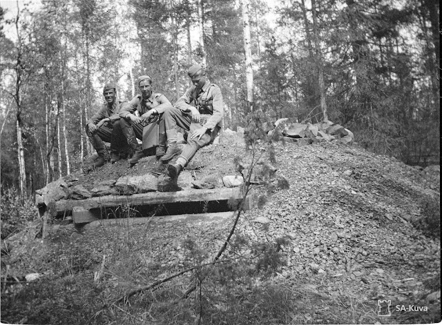 Finnish soldiers on captured Soviet tank, 26 July 1941 worldwartwo.filminspector.com
