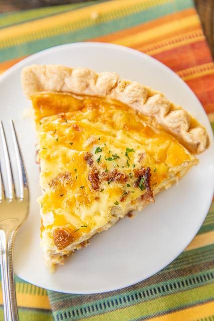 Crack Chicken Quiche - so quick and easy. Everyone LOVED this recipe!! Can make ahead and freeze for later. Pie crust, chicken, cheddar cheese, bacon, ranch dressing, heavy cream, and eggs Ready to eat in an hour. Great for breakfast, lunch or dinner. THE BEST! #quiche #chicken #freezermeal #bacon #ranch #cheddar