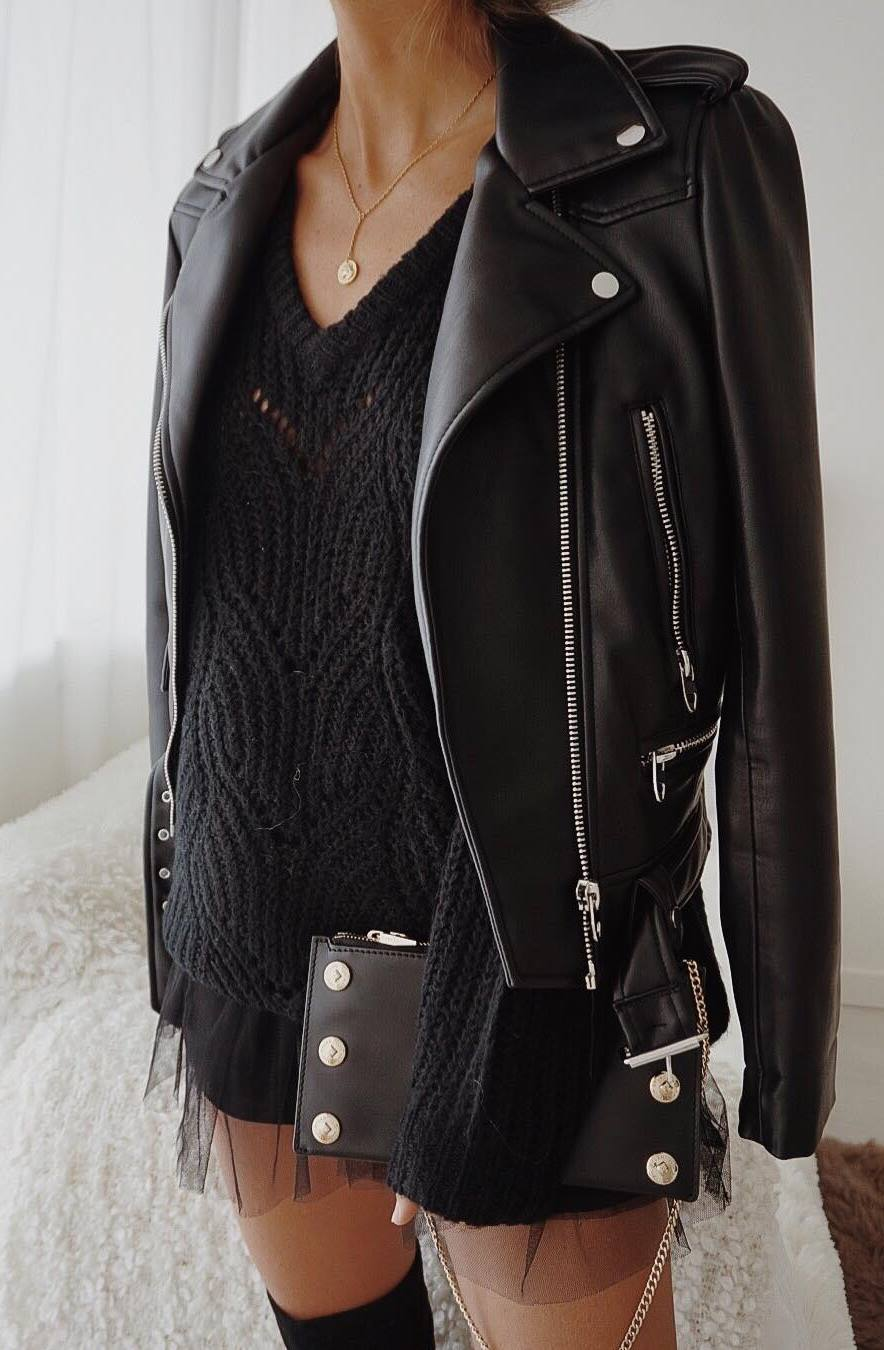 black on black_biker jacket + clutch + knit oversized sweater + skirt