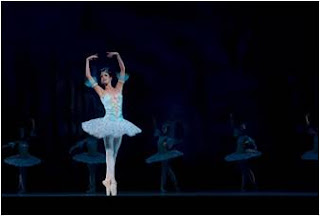 A ballerina performing her ballet act