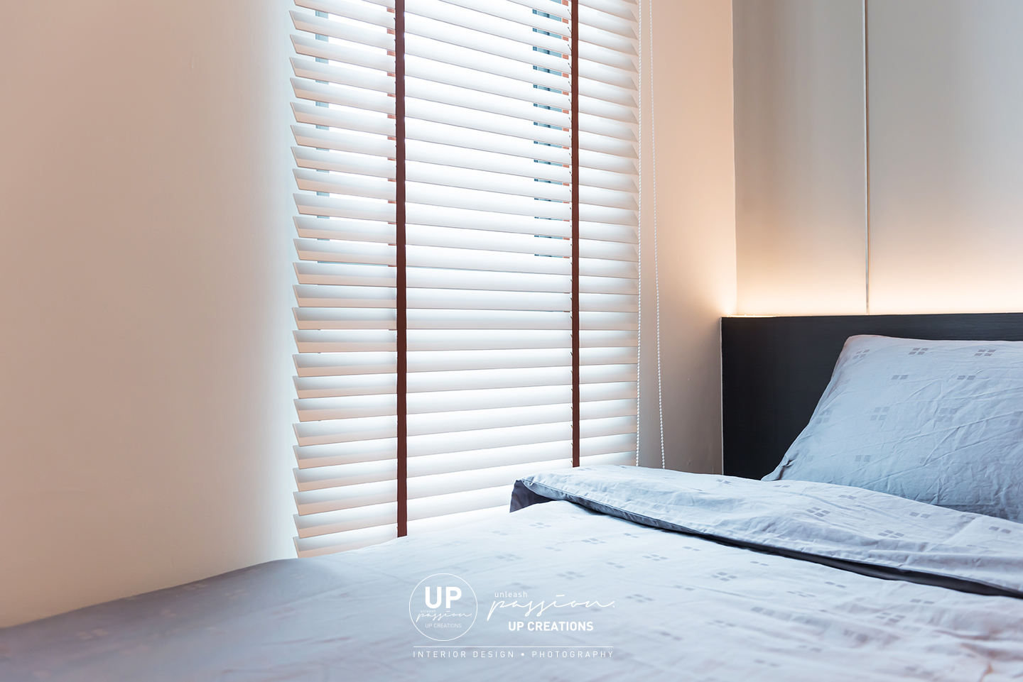 trinity aquata condo guest room with single bed with bedhead in led strip light and venetian blind