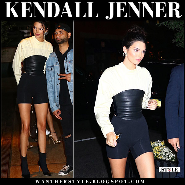Kendall Jenner in cream and black bustier shirt and black shorts model style june 4
