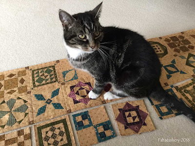 Suzi the cat helps with the Dear Jane Quilt