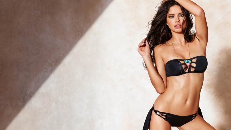 Adriana Lima strips to swimwear for Calzedonia