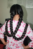 Twin Braids hairstyle photos women with very long hair