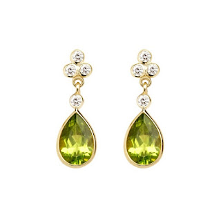 Fabulous Aphrodite earrings featuring Peridot and diamonds set in yellow gold from Aspinal London