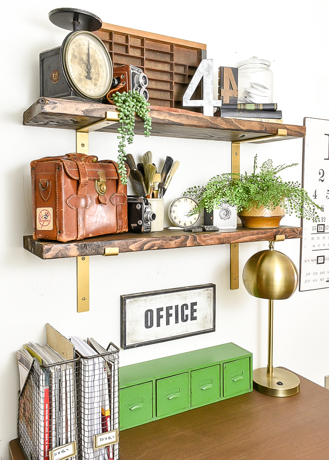vintage decor on wood and brass office shelves
