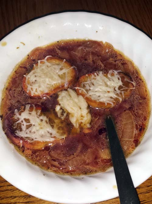 Slow cooked French Onion Soup without broiling. Followed a popular recipe from Allrecipes.com with changes because not all ingredients were available, including a working broiler. Still turned out great for a cold winter's night.