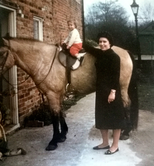 Photograph of author on her horse with her mother. Image courtesy of Nikki Greenleaf