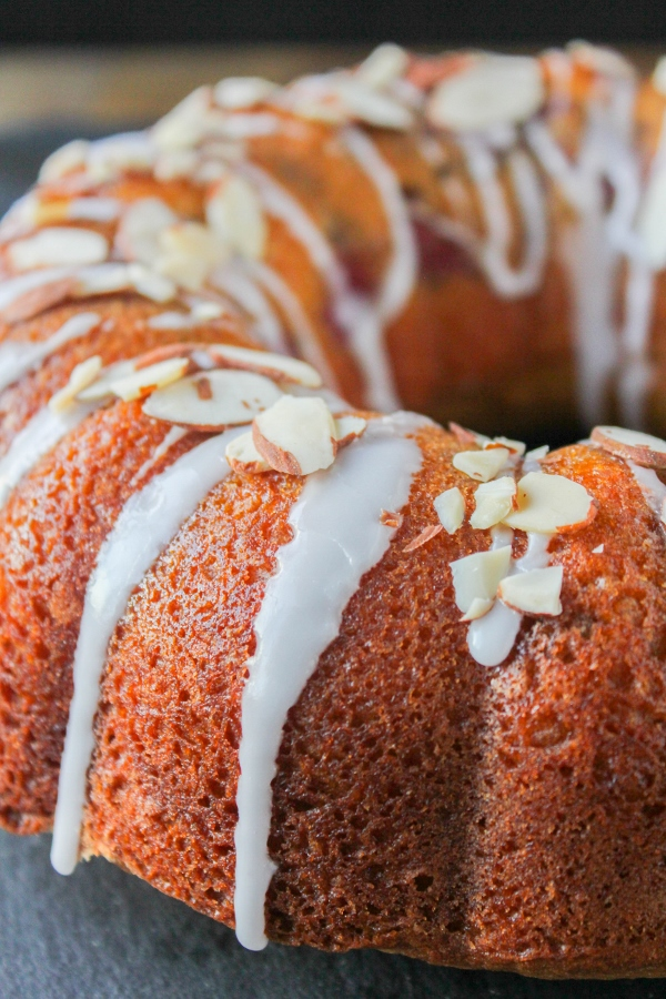 This Cherry Almond Coffee Cake is a sweet addition to any brunch menu. Made with fresh cherries, almond extract, and slivered almonds, this delicious cake will quickly become a family favorite!