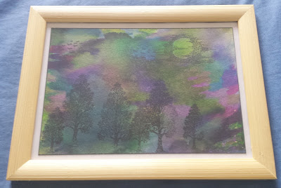 Evening landscape with trees in picture frame