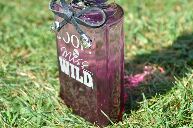 Perfume bottle sitting on the grass