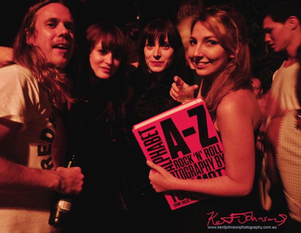 Rock fans with Tony Mott book at launch party. Tony Mott book launch Alphabet A-Z Rock 'N' Roll Photography. Photo by Kent Johnson