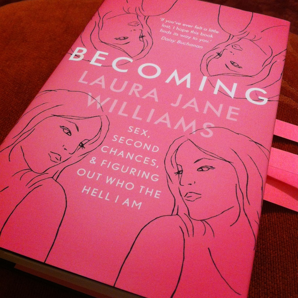 A photo of Becoming by Laura Jane Williams with page marking tabs sticking out the side