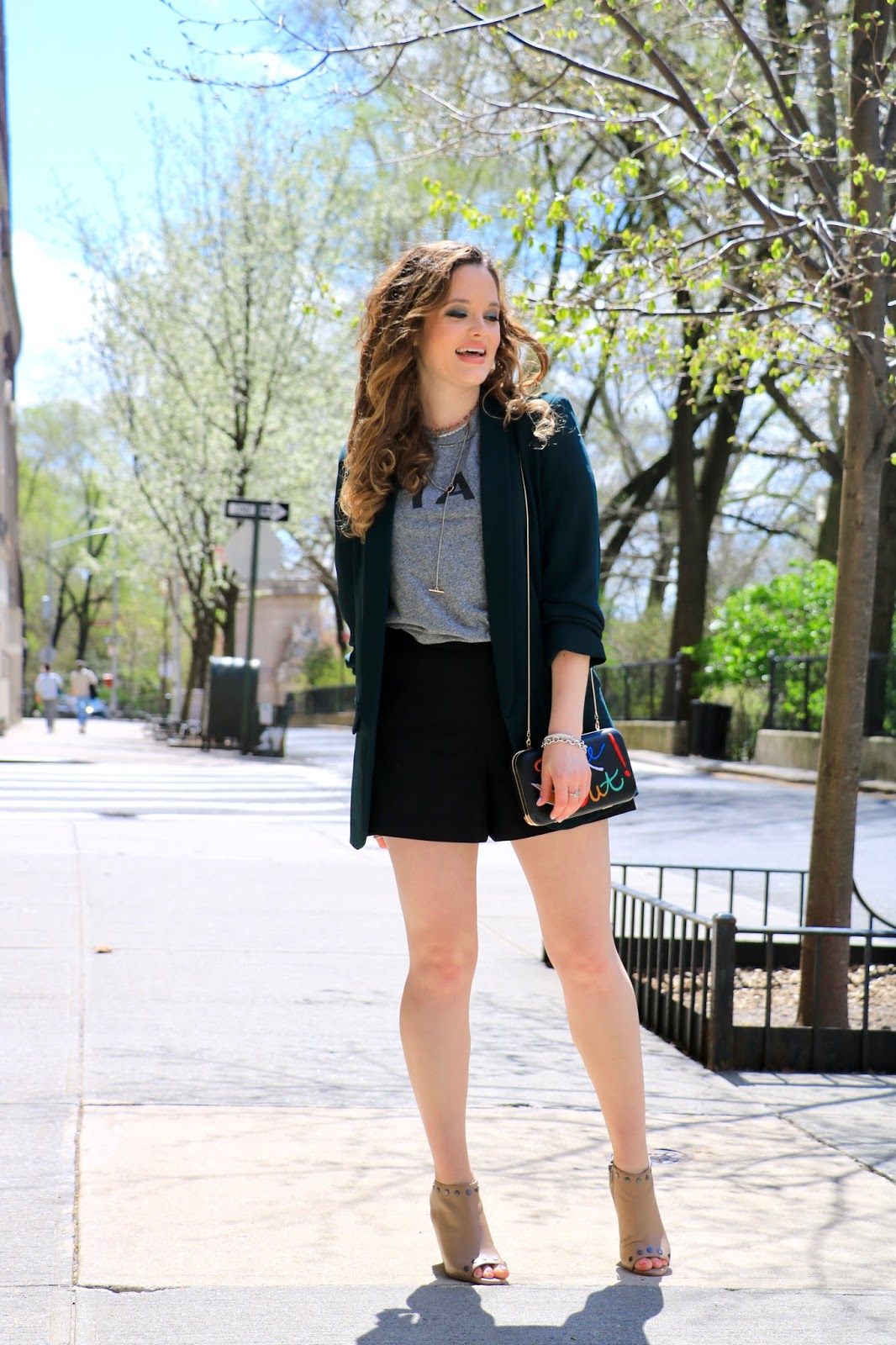 Nyc fashion blogger Kathleen Harper showing how to wear a blazer with shorts