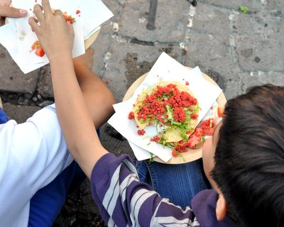 Boys sharing a tortilla in the central square (Zocalo) in Oaxaca, Mexico ♥ KitchenParade.com