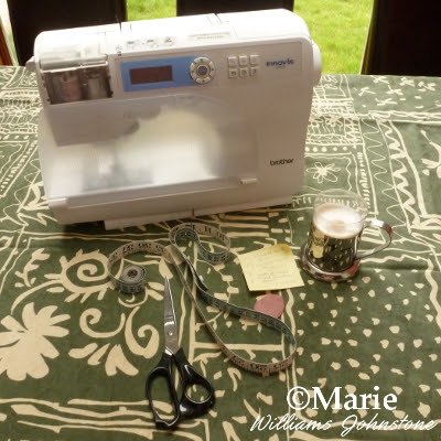Brother sewing machine, fabric, scissors, tailor's chalk and measuring tape