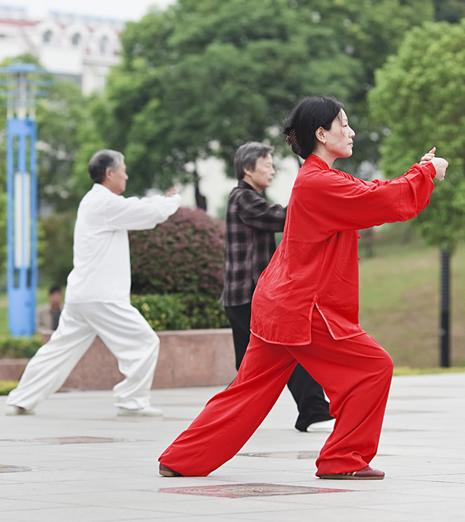 Doing tai chi in public park