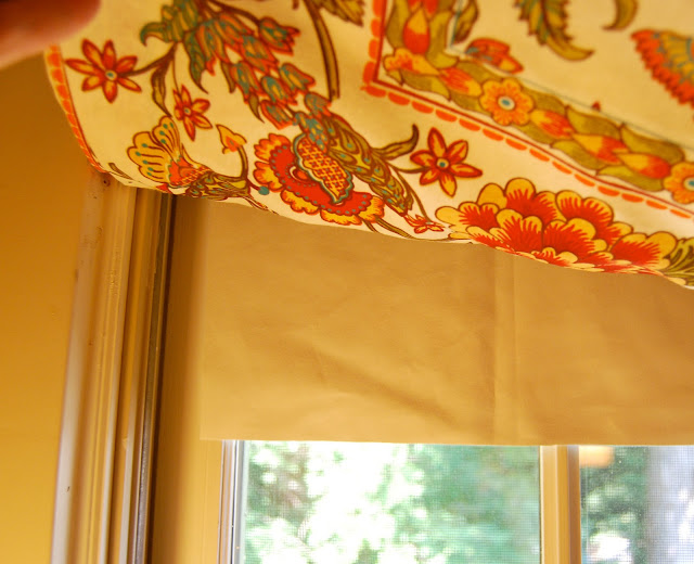 Using blackout fabric behind a faux Roman shade ensures that light doesn't show through the shade