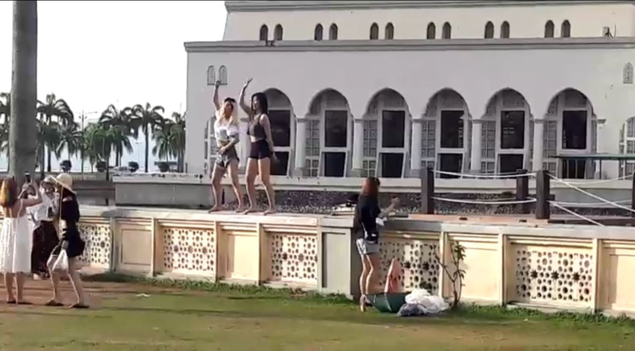 Tourists have been temporarily barred from visiting the iconic City Mosque here following a viral video of two women acting inappropriately.