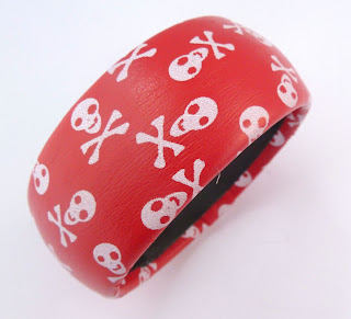 http://www.kcavintagegems.uk/chunky-red-and-white-skull-bangle-3747-p.asp