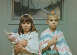 retro picture of two kids with stuffed animals