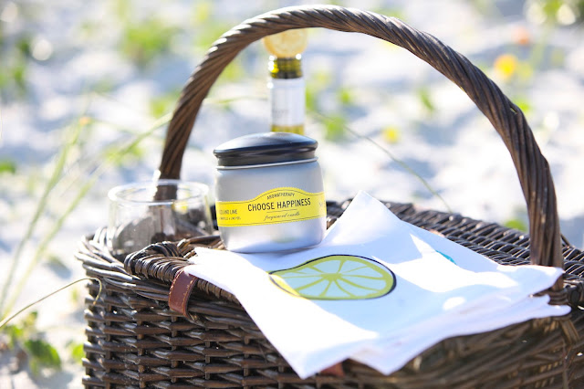 picnic basket with lemon napkin and candle