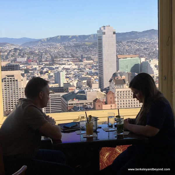 couple enjoying cocktails at the Top of the Mark in San Francisco, California