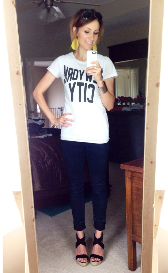 Graphic tee, black jeans and wedges