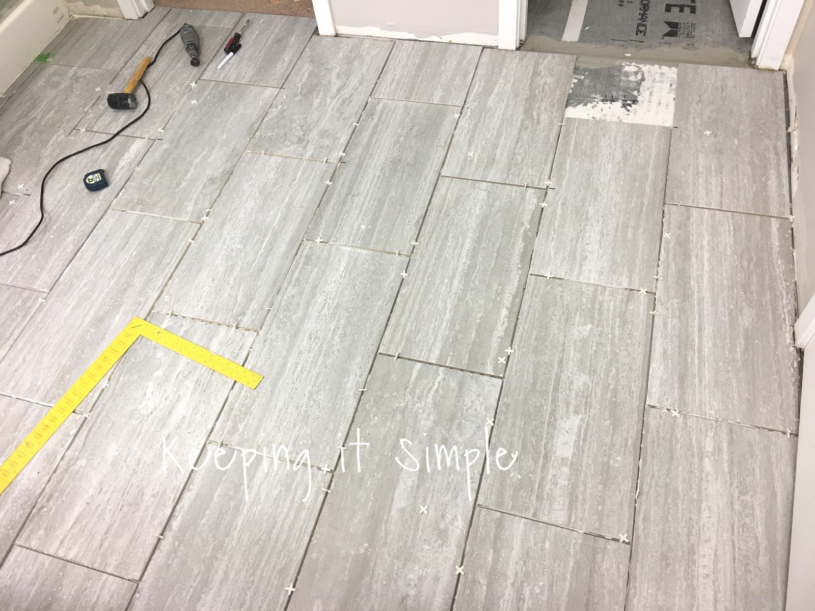 Tips on how to install tile flooring in a bathroom with ridgemont we did the toilet room later because we did the backer board a different time and had to wait for it to set thats why its not going into there yet dailygadgetfo Images