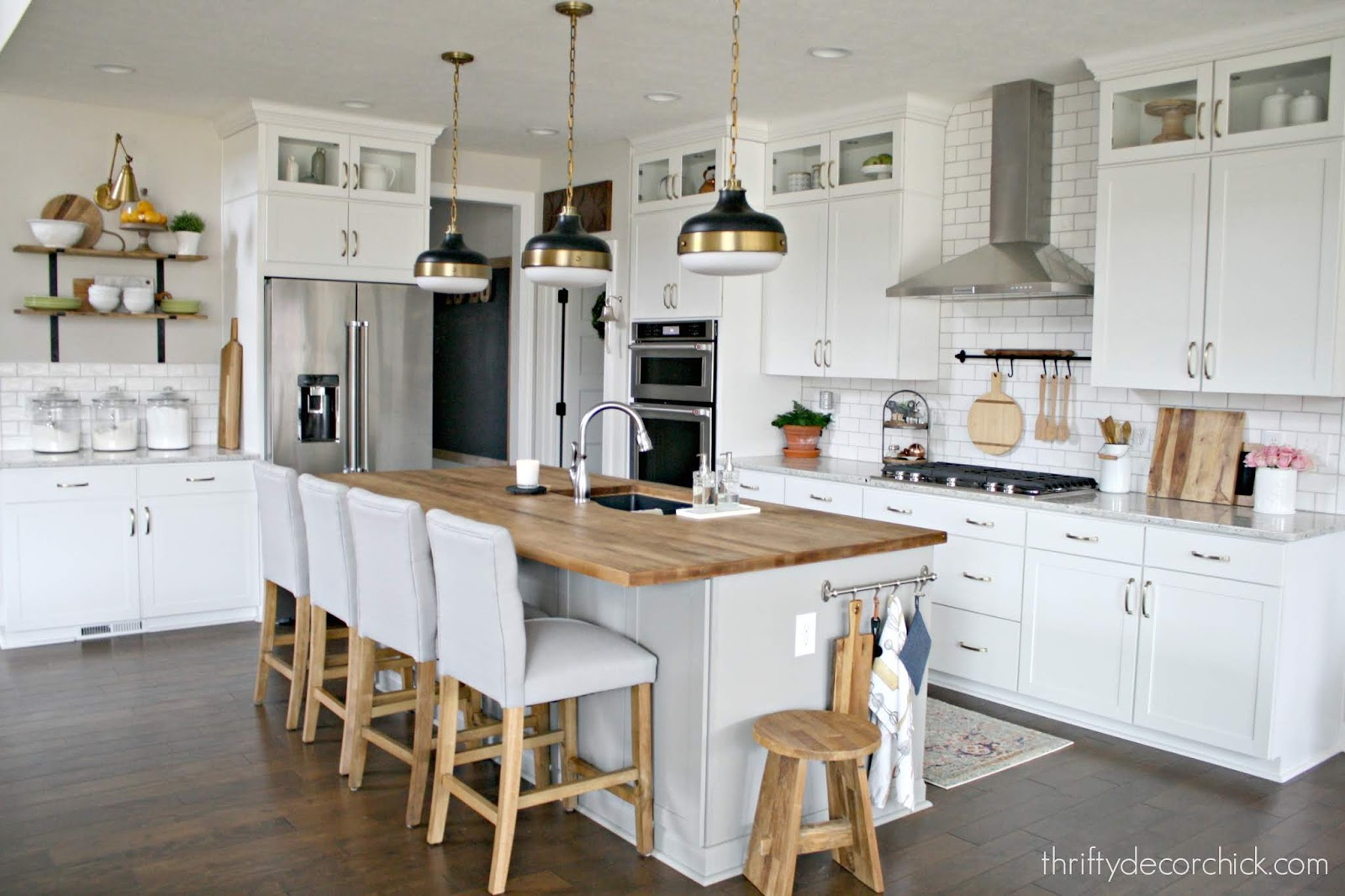 Warming up white kitchen with wood tones