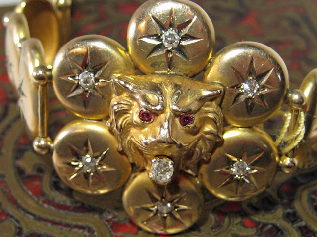 Victorian antique lion-headed bracelet in gold with diamonds and rubies.