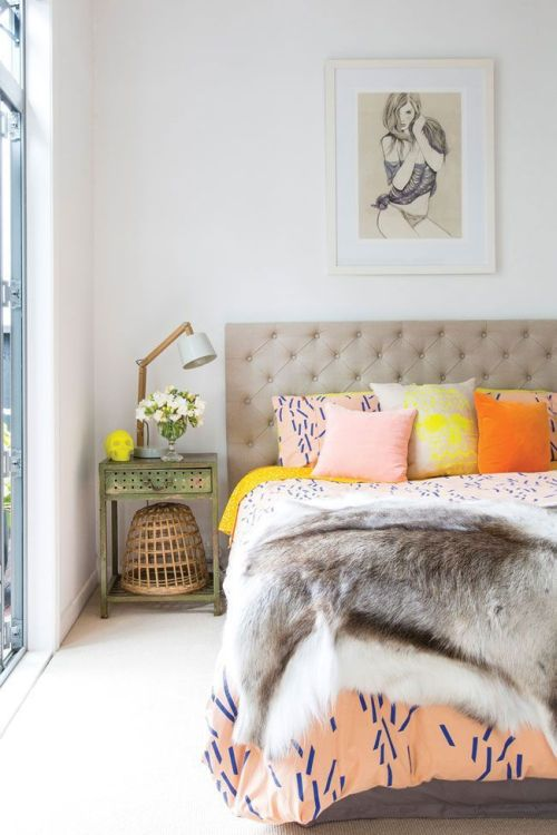 soft and warm bedroom with orange cushions