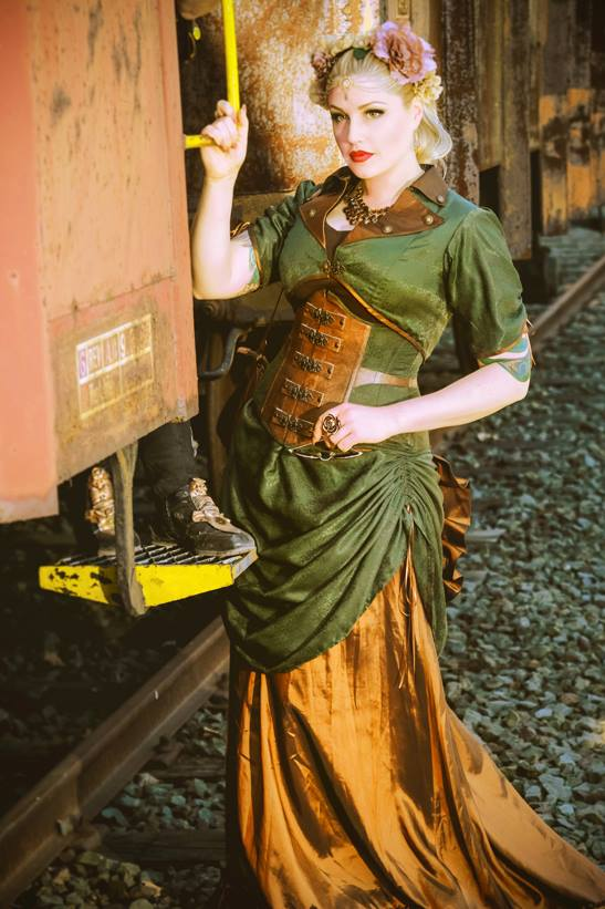 Woman in Steampunk clothing with flower headband/crown, corset and green dress