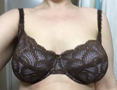 Someone wearing a bra, but it is not giving them much support