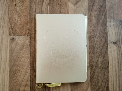 Gold notebook with Mickey Mouse icon