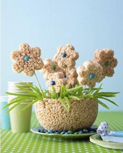 Bunga daisy ini terbuat dari sereal yang dicampur dengan mentega, dipadatkan lalu dibentuk menjadi pot dan bunga. Ide menyenangkan untuk dibuat bersama anak-anak.