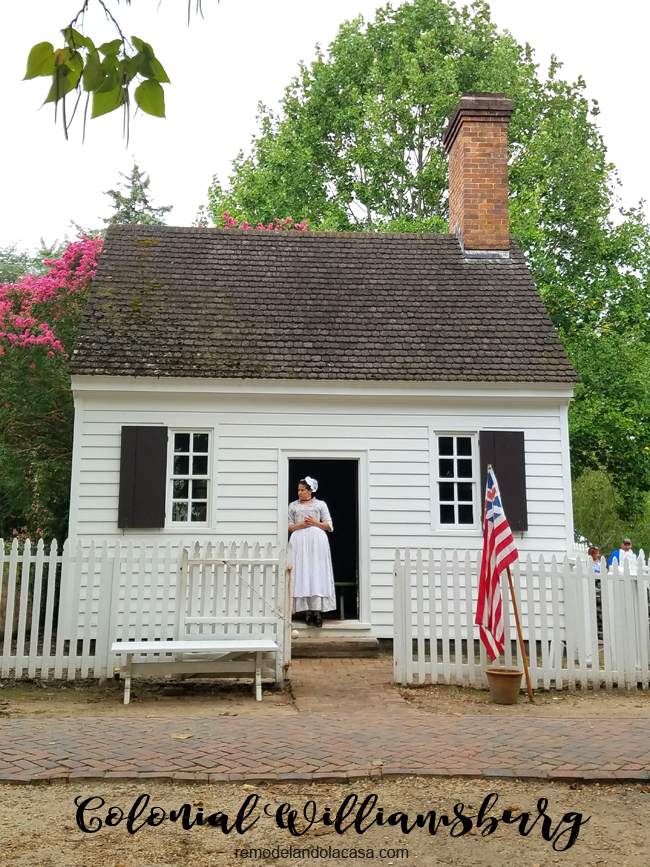white little house with lady in the front door - Colonial Williamsburg