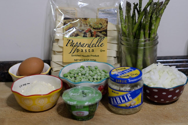 A picture of the ingredients needed to make the pea and asparagus carbonara.