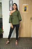 Pragya Jaiswal in a single Sleeves Off Shoulder Green Top Black Leggings promoting JJN Movie at Radio City 10.08.2017 070.JPG