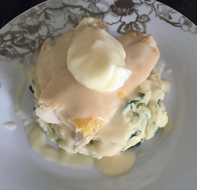 smoked haddock with poached eggs, spinachy mash and hollandaise