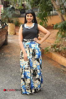 Actress Model Poorni Stills in Floral Long Dress at Silk India Expo Launch  0030.JPG