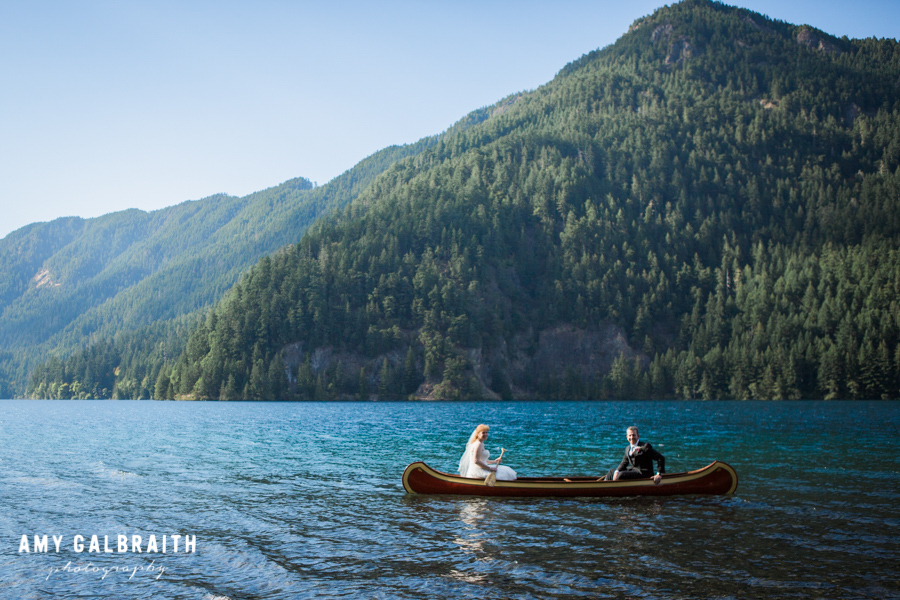 bride and groom in canoe on turquoise lake