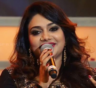 Rimi Tomy Family Husband Son Daughter Father Mother Marriage Photos Biography Profile.