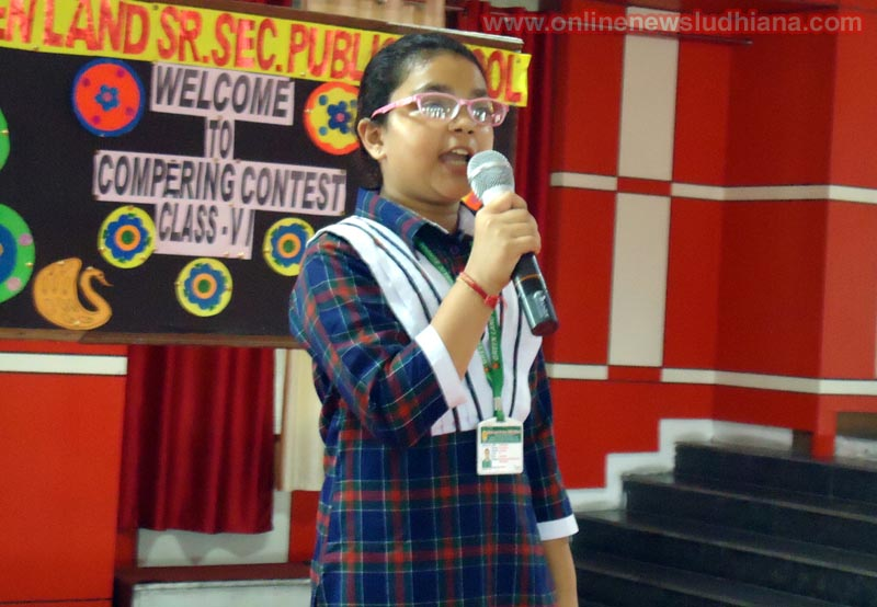 A student speaks during Compering Contest at Green Land