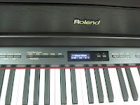 Roland HP507 digital piano display screen