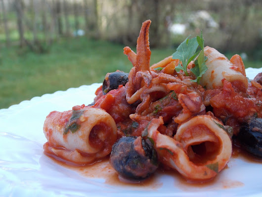 Squid In Spicy Tomato Sauce with Black Olives