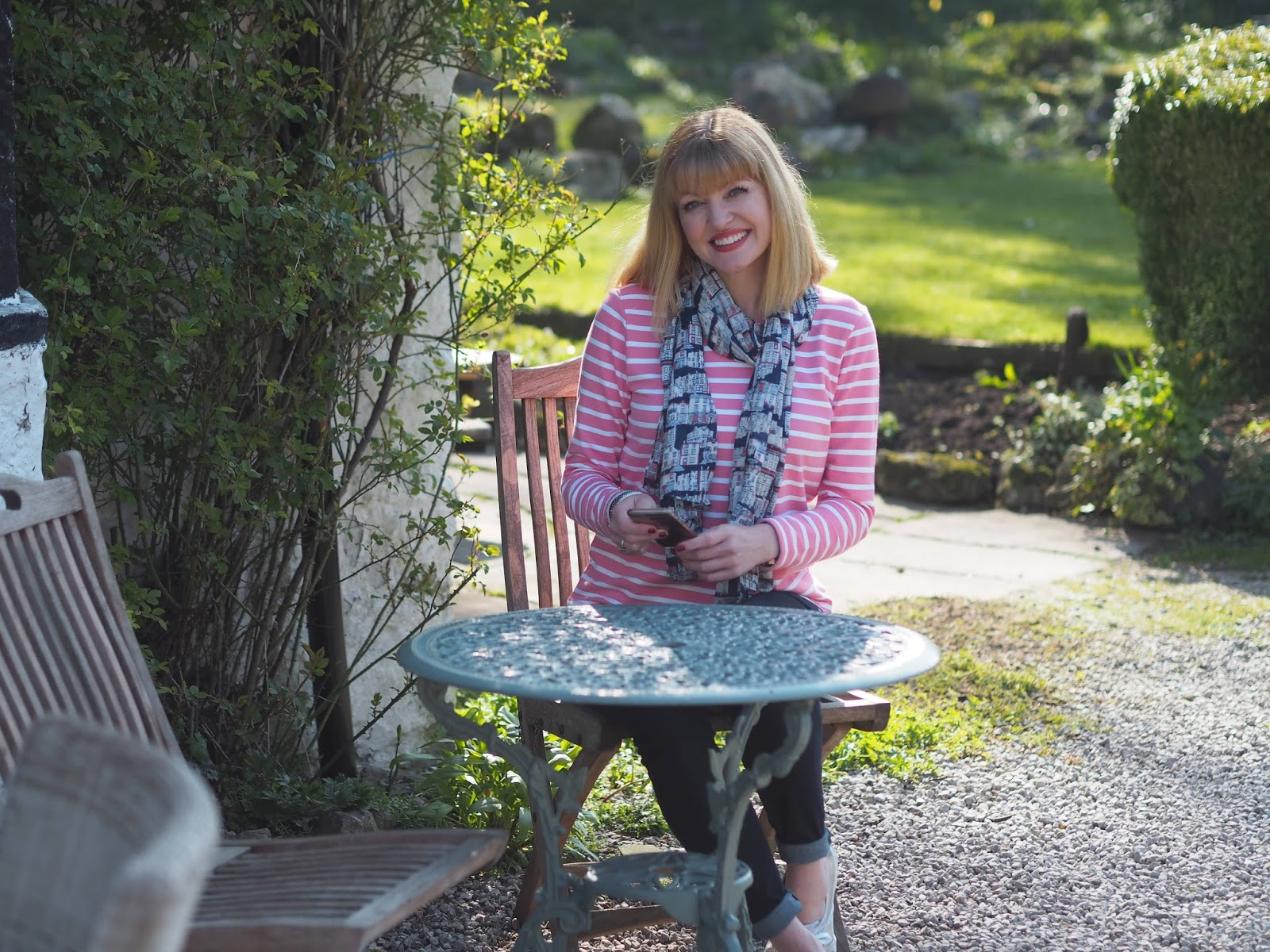 pink and white striped breton top by Tulchan with skinny jeans and silver Superga pumps, outdoors
